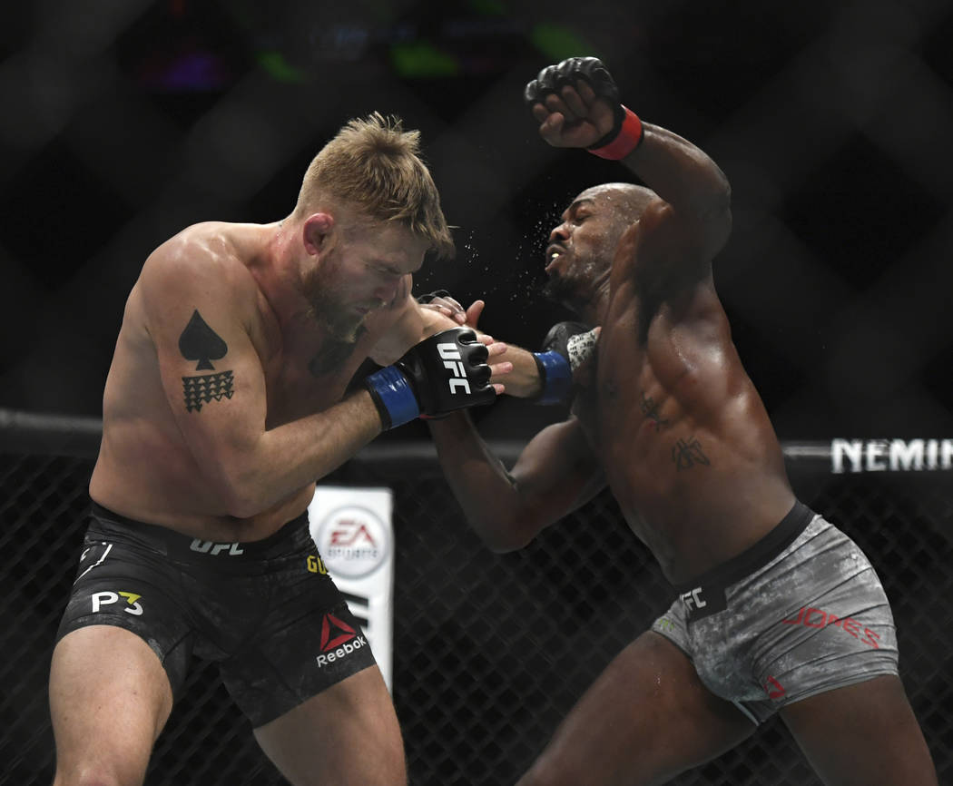 Alexander Gustafsson, left, and Jon Jones exchange punches during the UFC men's light heavyweight mixed martial arts bout at UFC 232, Saturday, Dec. 29, 2018, in Inglewood, Calif. (AP Photo/Kyusun ...