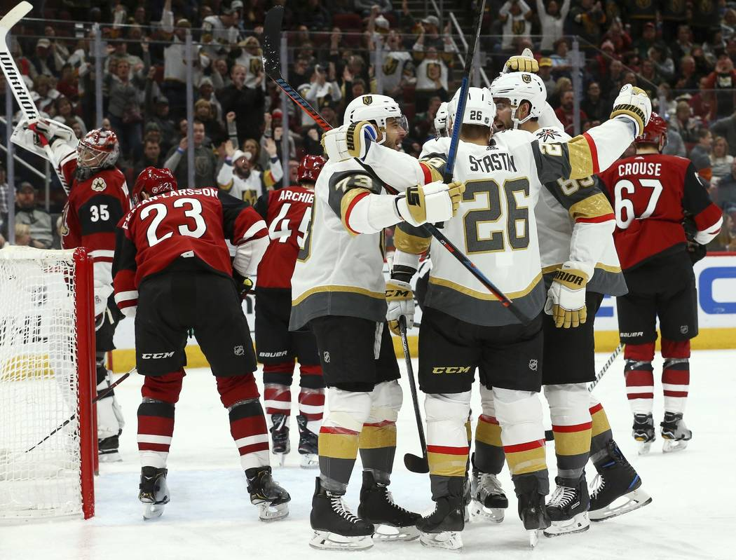 Vegas Golden Knights center Paul Stastny (26) celebrates his goal against the Arizona Coyotes with left wing Valentin Zykov (73) and right wing Alex Tuch (89) as Coyotes goaltender Darcy Kuemper ( ...