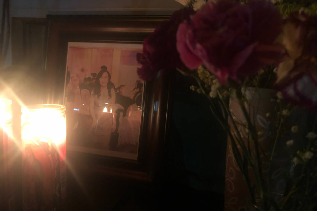 A photo of Nhu Nguyen is displayed in a makeshift memorial in front of Crystal Nails & Spa in Las Vegas on Sunday, Dec. 30, 2018. Nguyen was killed a day prior outside the salon after a customer w ...
