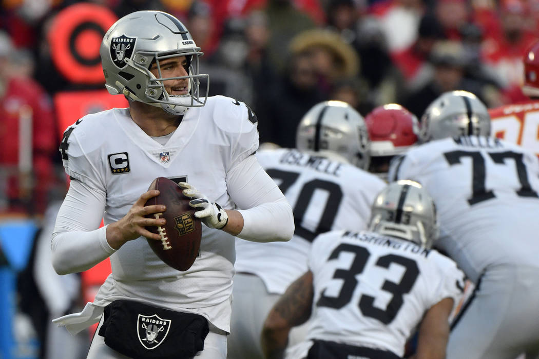 Oakland Raiders quarterback Derek Carr (4) looks for a receiver during the first half of an NFL football game against the Kansas City Chiefs in Kansas City, Mo., Sunday, Dec. 30, 2018. (AP Photo/E ...