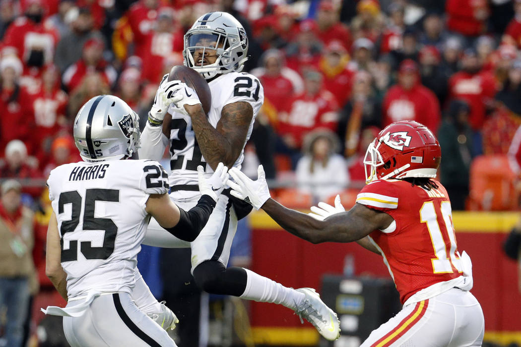 Oakland Raiders safety Erik Harris (25) watches as cornerback Gareon Conley (21) intercepts a pass intended for Kansas City Chiefs wide receiver Tyreek Hill, right, during the first half of an NFL ...