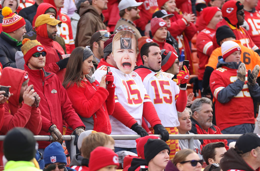 A Kansas City Chiefs fan wears a mask before the start of an NFL game against the Oakland Raiders in Kansas City, Mo., Sunday, Dec. 30, 2018. Heidi Fang Las Vegas Review-Journal @HeidiFang