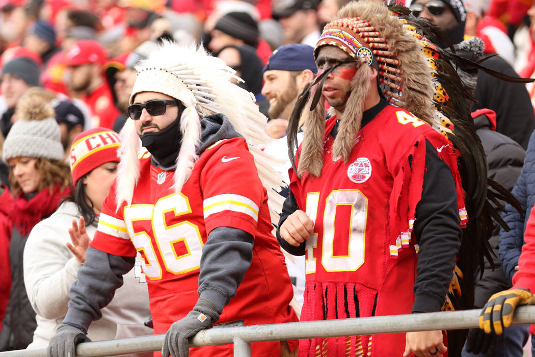 Kansas City Chiefs fans wear headdresses during the first half of an NFL game against the Oakland Raiders in Kansas City, Mo., Sunday, Dec. 30, 2018. Heidi Fang Las Vegas Review-Journal @HeidiFang