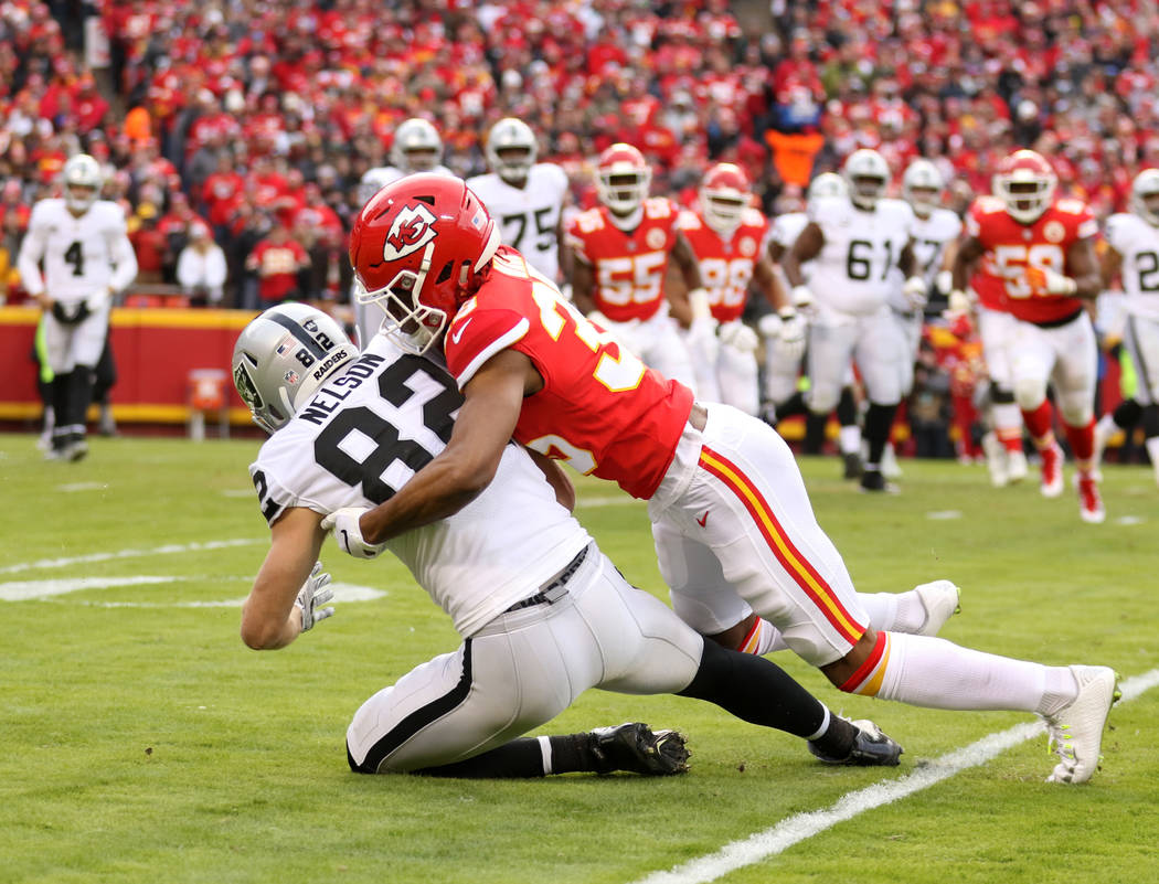 Kansas City Chiefs cornerback Charvarius Ward (35) tackles Oakland Raiders wide receiver Jordy Nelson (82) during the first half of an NFL game in Kansas City, Mo., Sunday, Dec. 30, 2018. Heidi Fa ...