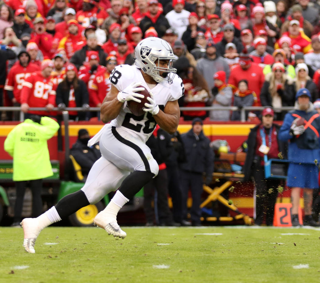 Oakland Raiders running back Doug Martin (28) runs with the football during the first half of an NFL game against the Kansas City Chiefs in Kansas City, Mo., Sunday, Dec. 30, 2018. Heidi Fang Las ...