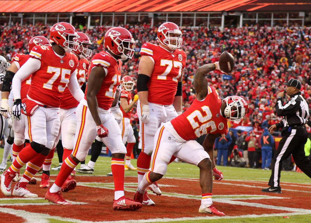 Kansas City Chiefs running back Damien Williams (26) spikes the football after scoring a touchdown during the first half of an NFL game against the Oakland Raiders in Kansas City, Mo., Sunday, Dec ...