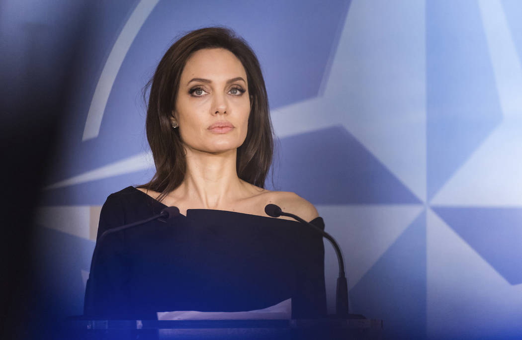 FILE - In this file photo dated Wednesday, Jan. 31, 2018, Special Envoy for the United Nations High Commissioner for Refugees Angelina Jolie addresses the media at NATO headquarters in Brussels. ...