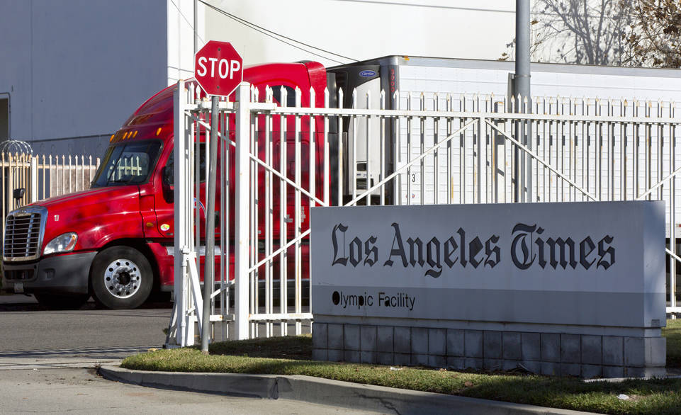 A truck is parked outside the Los Angeles Times Olympic Facility in Los Angeles, Sunday, Dec. 30, 2018. (AP Photo/Damian Dovarganes)