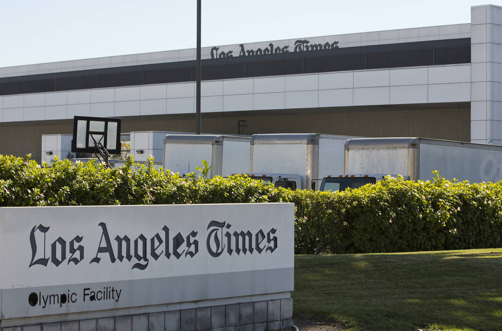 Delivery trucks are parked outside the Los Angeles Times Olympic Facility in Los Angeles, Sunday, Dec. 30, 2018. (AP Photo/Damian Dovarganes)