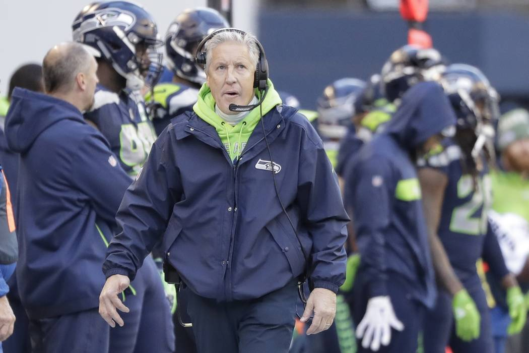 Seattle Seahawks head coach Pete Carroll looks toward the clock during the first half of an NFL football game against the Arizona Cardinals, Sunday, Dec. 30, 2018, in Seattle. (AP Photo/Ted S. Warren)