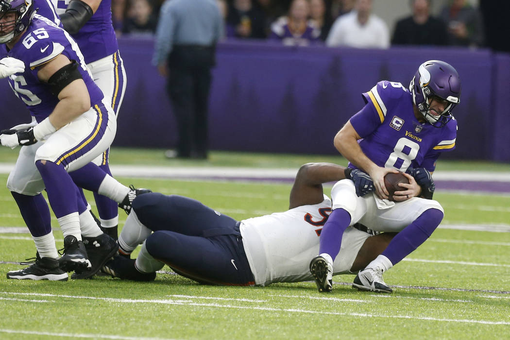 Minnesota Vikings quarterback Kirk Cousins (8) is sacked by Chicago Bears nose tackle Eddie Goldman during the first half of an NFL football game, Sunday, Dec. 30, 2018, in Minneapolis. (AP Photo/ ...
