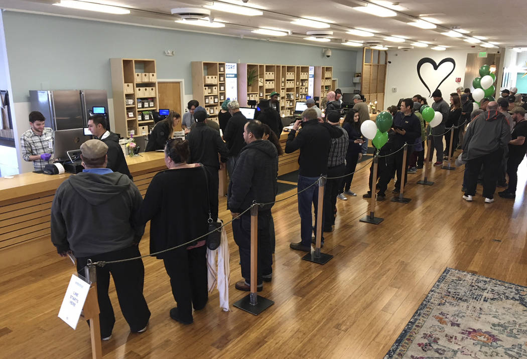 In this Jan. 4, 2018, file photo, customers line up inside the Harborside cannabis dispensary in Oakland, Calif. (AP Photo/Terry Chea, file)