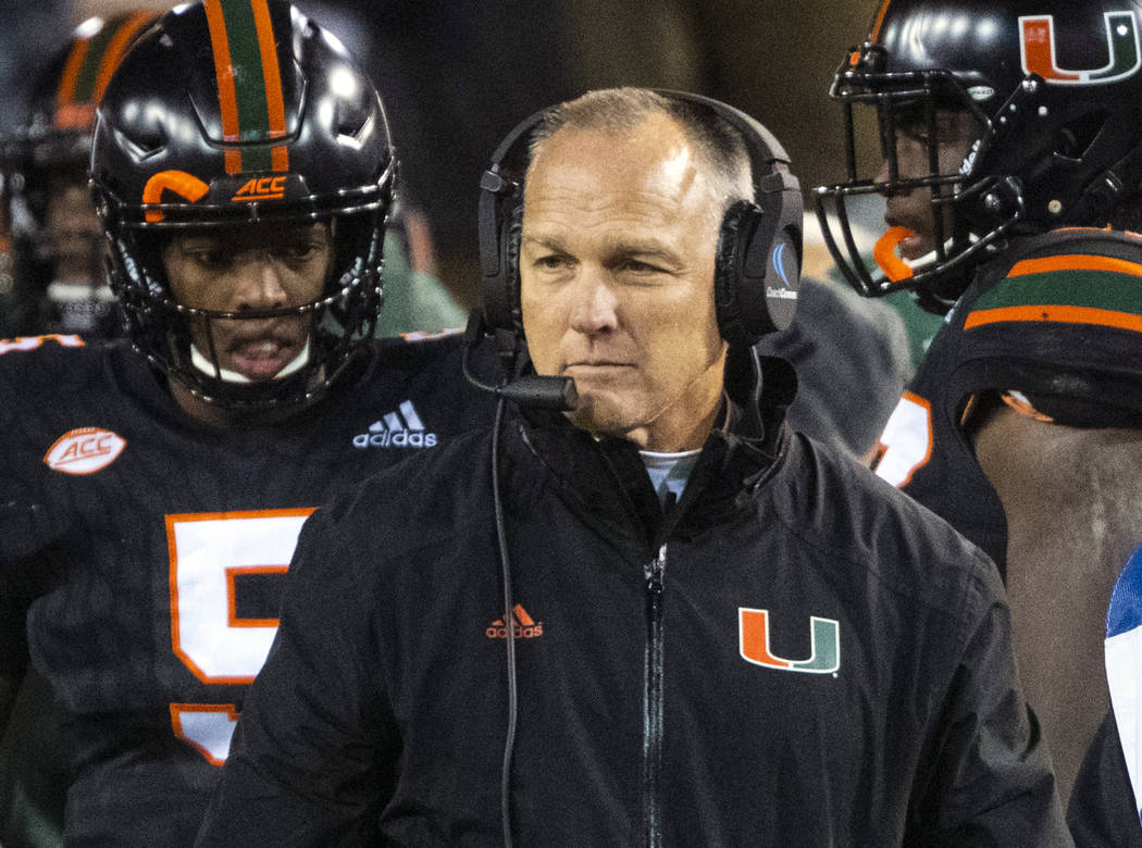 In this Nov. 10, 2018, file photo, Miami coach Mark Richt walks the sideline during the second half of an NCAA college football game against Georgia Tech in Atlanta. (AP Photo/John Amis, File)
