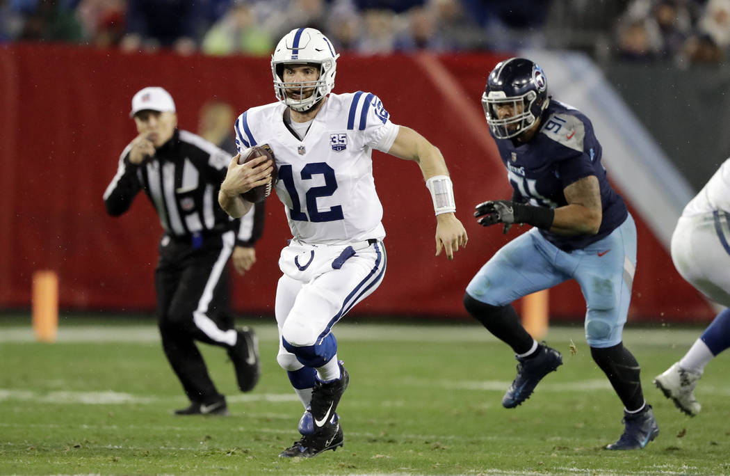 Indianapolis Colts quarterback Andrew Luck (12) scrambles against the Tennessee Titans in the second half of an NFL football game Sunday, Dec. 30, 2018, in Nashville, Tenn. (AP Photo/James Kenney)