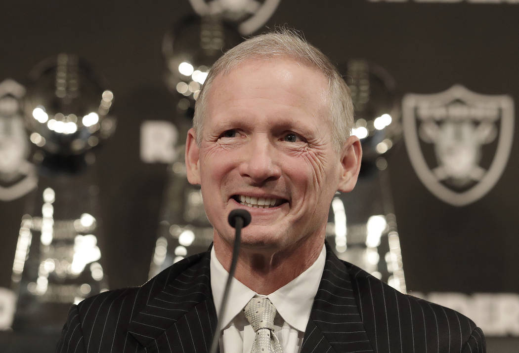 Mike Mayock smiles as at a news conference where he was introduced as the new Oakland Raiders general manager at the team's headquarters in Oakland, Calif., Monday, Dec. 31, 2018. (AP Photo/Jeff Chiu)