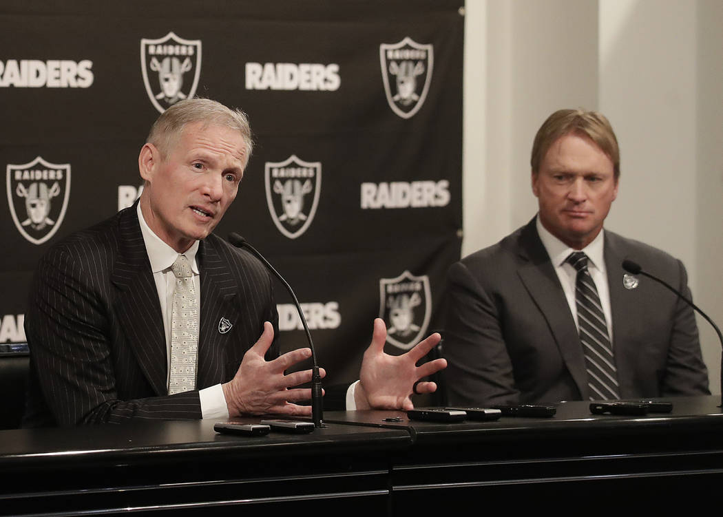 Mike Mayock, left, gestures next to Oakland Raiders head coach Jon Gruden at a news conference announcing Mayock as the general manager at the team's headquarters in Oakland, Calif., Monday, Dec. ...
