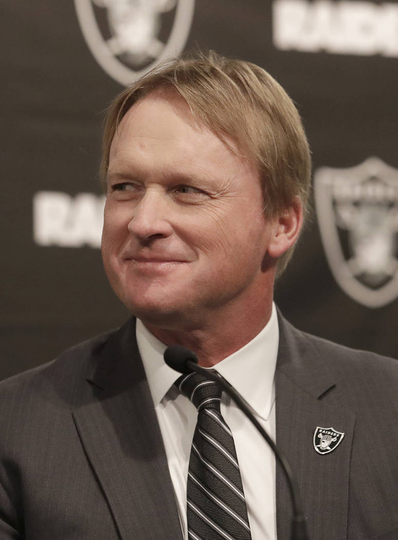Oakland Raiders head coach Jon Gruden listens to speakers at a news conference announcing Mike Mayock as the team's general manager at the team's headquarters in Oakland, Calif., Monday, Dec. 31, ...