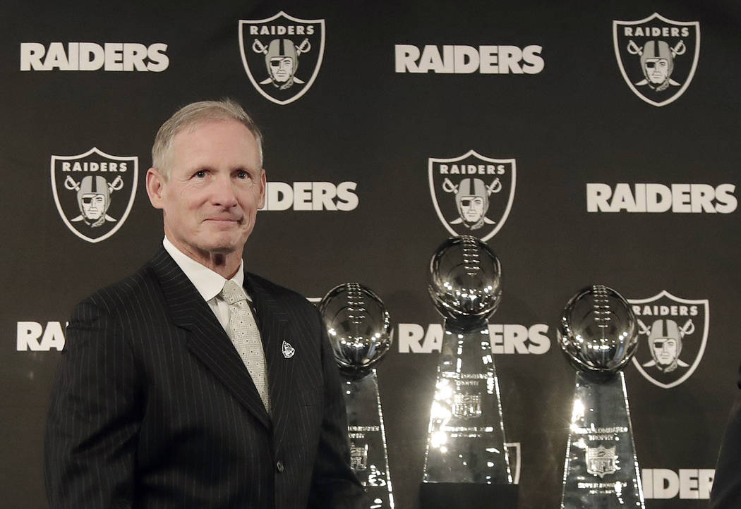 Mike Mayock arrives at a news conference announcing him as the new Oakland Raiders general manager at the team's headquarters in Oakland, Calif., Monday, Dec. 31, 2018. (AP Photo/Jeff Chiu)