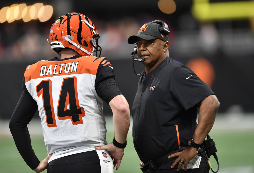Cincinnati Bengals head coach Marvin Lewis speaks with Cincinnati Bengals quarterback Andy Dalton (14) during the first half of an NFL football game, Sunday, Sept. 30, 2018, in Atlanta. (John Amis/AP)