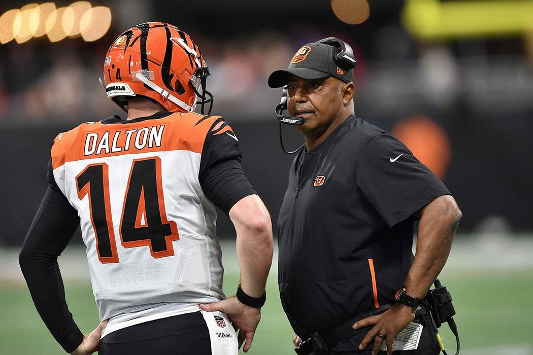 Cincinnati Bengals head coach Marvin Lewis speaks with Cincinnati Bengals quarterback Andy Dalton (14) during the first half of an NFL football game, Sunday, Sept. 30, 2018, in Atlanta. (AP Photo/ ...