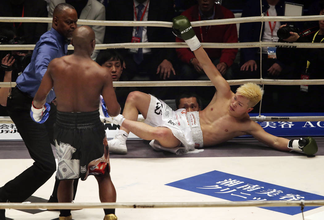 Japanese kickboxer Tenshin Nasukawa lies on the mat after being knocked out by Floyd Mayweather Jr. during first round of their three-round exhibition match on New Year's Eve, at Saitama Super Are ...