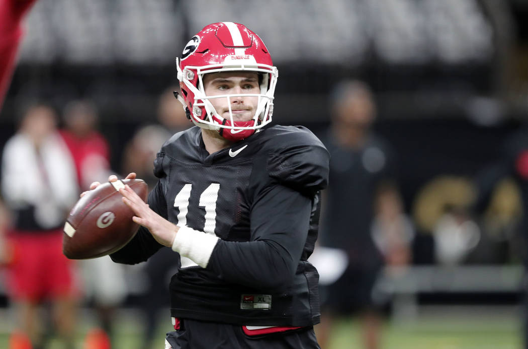 Georgia quarterback Jake Fromm (11) practices at the Superdome in New Orleans, Friday, Dec. 28, 2018. Georgia will face Texas in the Sugar Bowl NCAA college football game on Jan. 1, 2019. (AP Phot ...