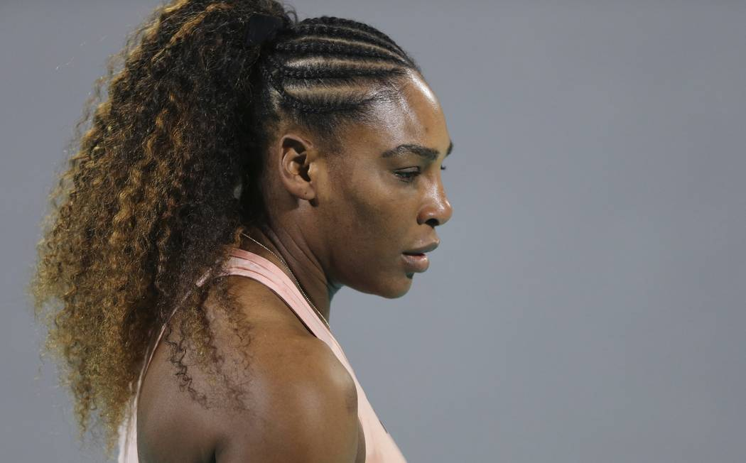 Serena Williams from the U.S. reacts during a match against her sister Venus, on the opening day of the Mubadala World Tennis Championship in Abu Dhabi, United Arab Emirates, Thursday, Dec. 27, 20 ...
