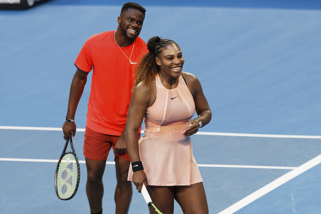 Serena Williams and Frances Tiafoe of the United States during their mixed doubles match against Stefanos Tsitsipass and Maria Sakkari of Greece at the Hopman Cup in Perth, Australia, Monday Dec. ...