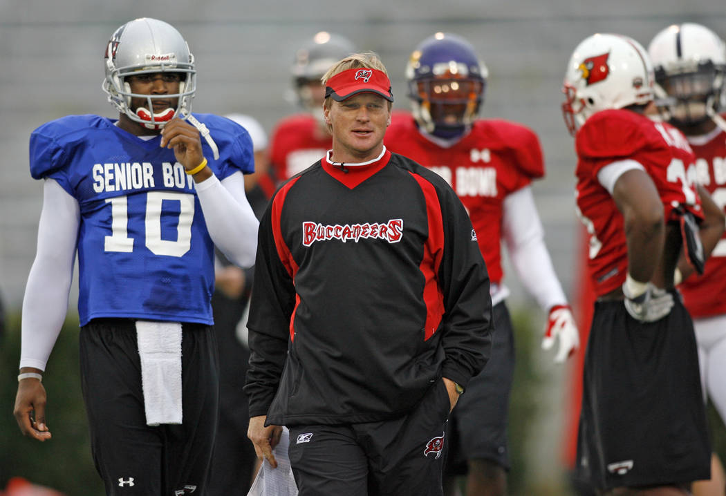 North Squad football coach Jon Gruden of the Tampa Bay Buccaneers works with his players during practice for this Saturday's Senior Bowl at Ladd Peebles Stadium in Mobile, Ala. Monday, Jan 22, 200 ...