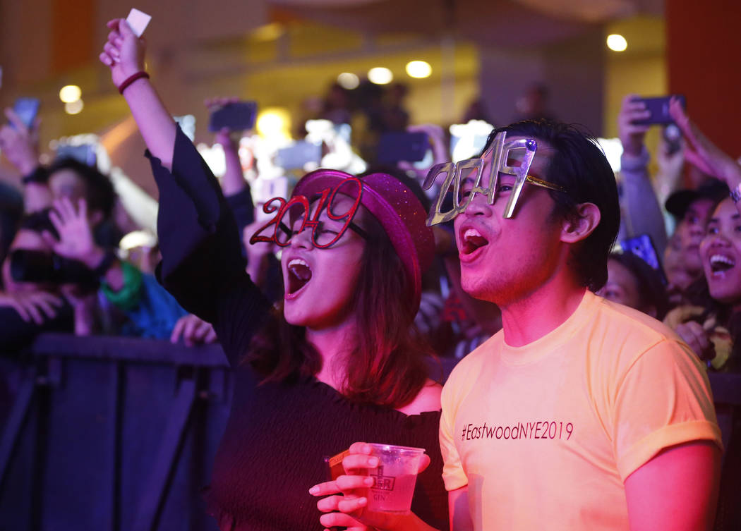 Filipinos cheer during a New Year countdown at the Eastwood Shopping Mall late Monday, Dec. 31, 2018 in suburban Quezon city northeast of Manila, Philippines. Filipinos welcome the New Year with t ...
