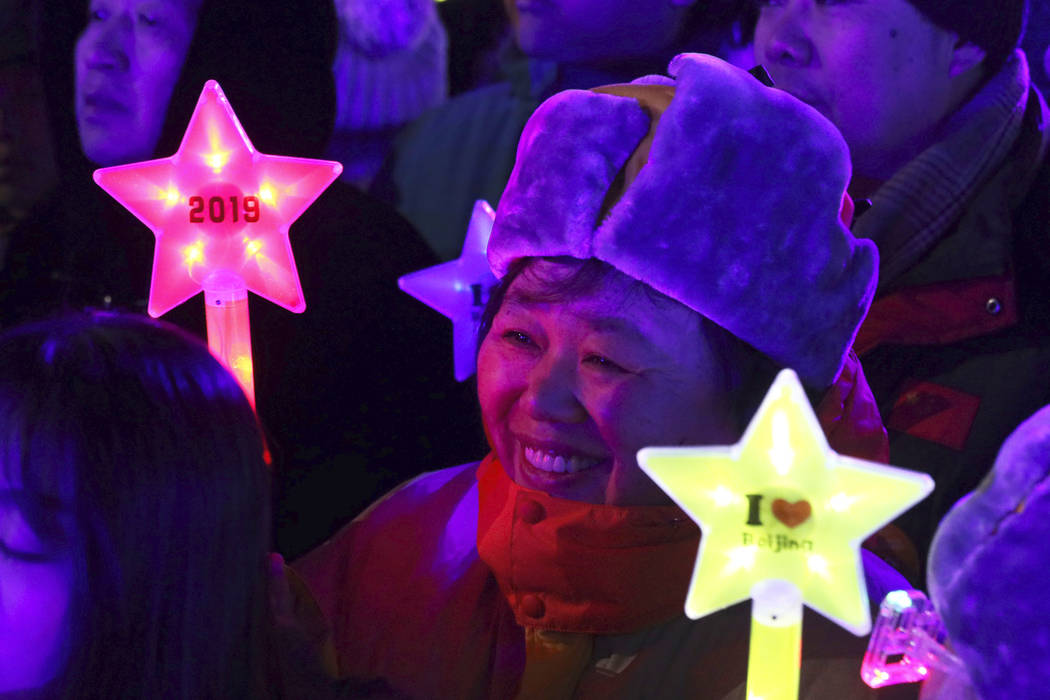 A reveler prepares to countdown to the new year in Beijing, China, Monday, Dec. 31, 2018. (Ng Han Guan/AP)