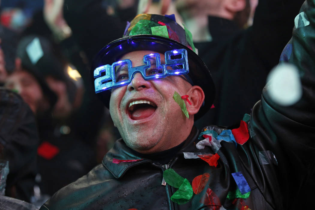A reveler celebrates as confetti falls during a New Year's celebration in New York's Times Square, Tuesday, Jan. 1, 2019. (AP Photo/Adam Hunger)