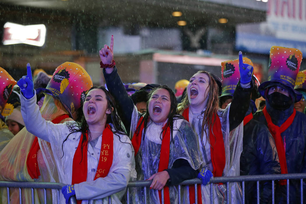 Revelers cheer as they gather in New York's Times Square, Monday, Dec. 31, 2018, as they take part in a New Year's Eve celebration. (AP Photo/Adam Hunger)