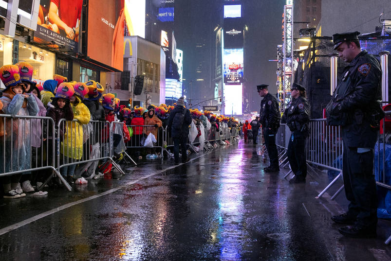 New York Police Department officers patrol as people gather at Times Square in New York, Monday, Dec. 31, 2018, for a New Year's celebration. (AP Photo/Craig Ruttle)