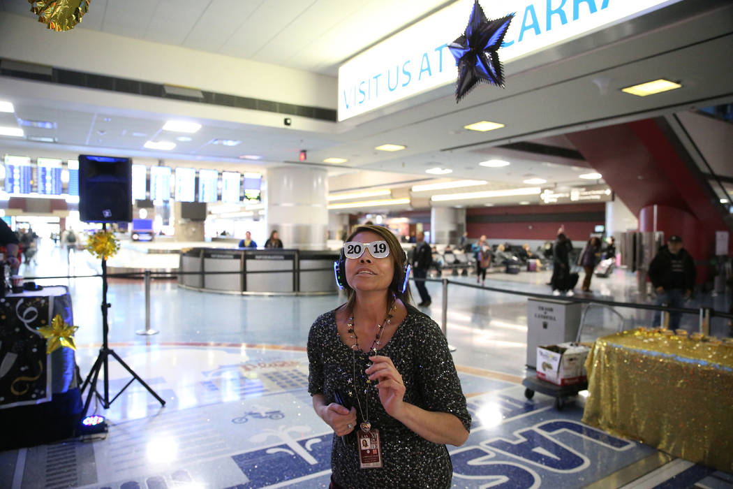 Airport spokeswoman Gabriela Muro participates in the silent disco dance party during a New Year's Eve celebration at McCarran International Airport in Las Vegas, Monday, Dec. 31, 2018. Erik Verdu ...