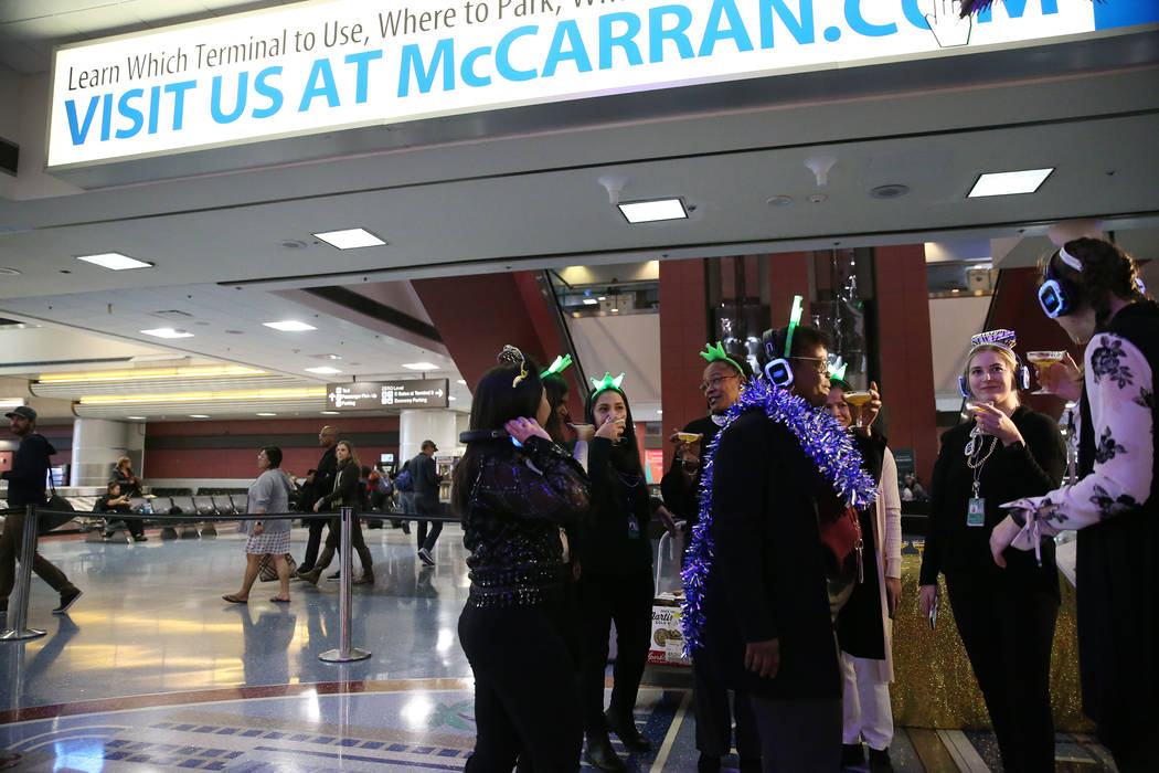 People participate in a toast with apple cider during a New Year's Eve celebration at McCarran International Airport in Las Vegas, Monday, Dec. 31, 2018. Erik Verduzco Las Vegas Review-Journal @Er ...