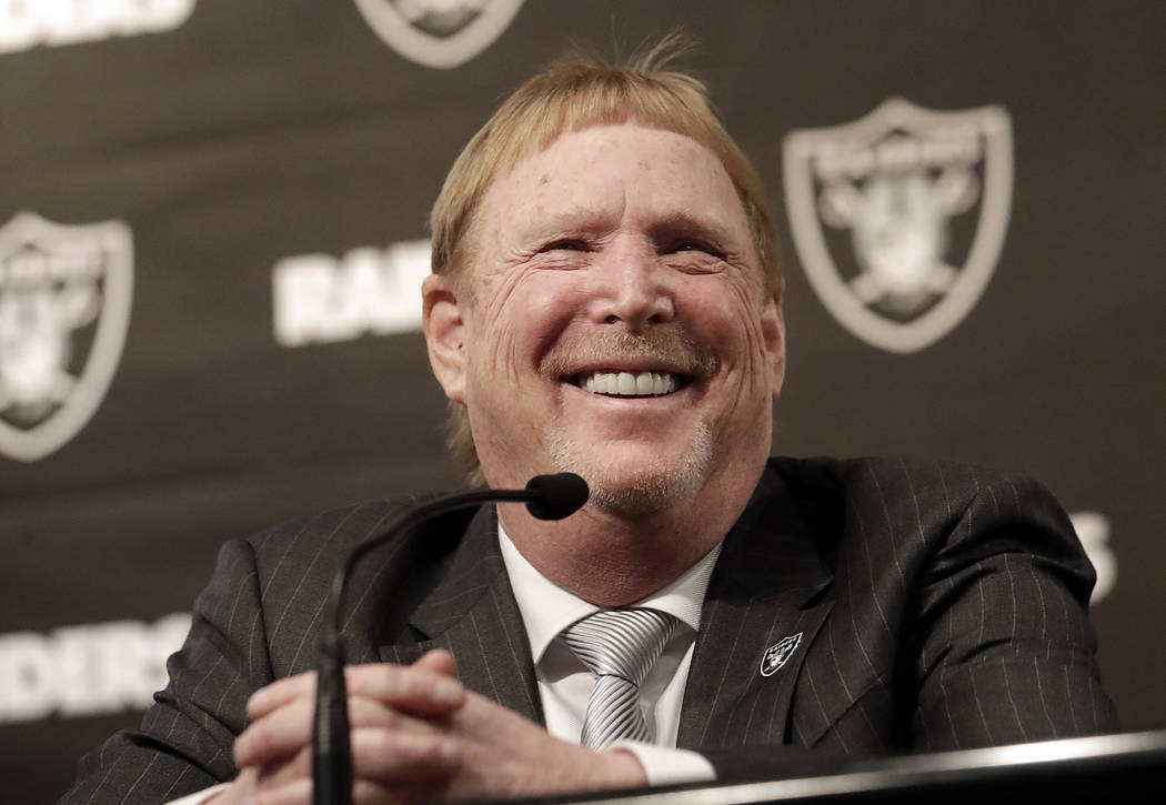 Oakland Raiders owner Mark Davis smiles at at a news conference introducing Mike Mayock as the team's general manager at the team's headquarters in Oakland, Calif., Monday, Dec. 31, 2018. (AP Phot ...