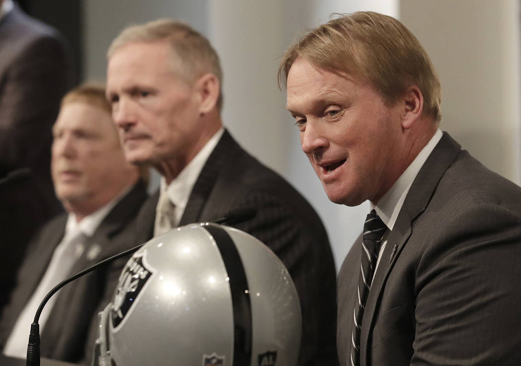 Oakland Raiders head coach Jon Gruden, right, speaks next to Mike Mayock, center, and owner Mark Davis at a news conference announcing Mayock as the general manager at the team's headquarters in O ...
