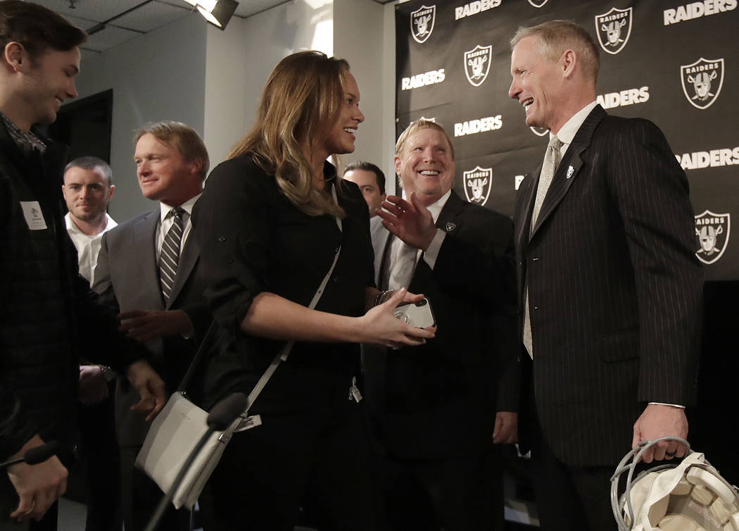 Mike Mayock, right, introduces members of his family to Oakland Raiders owner Mark Davis, second from right, and head coach Jon Gruden, third from left, at a news conference announcing Mayock as t ...