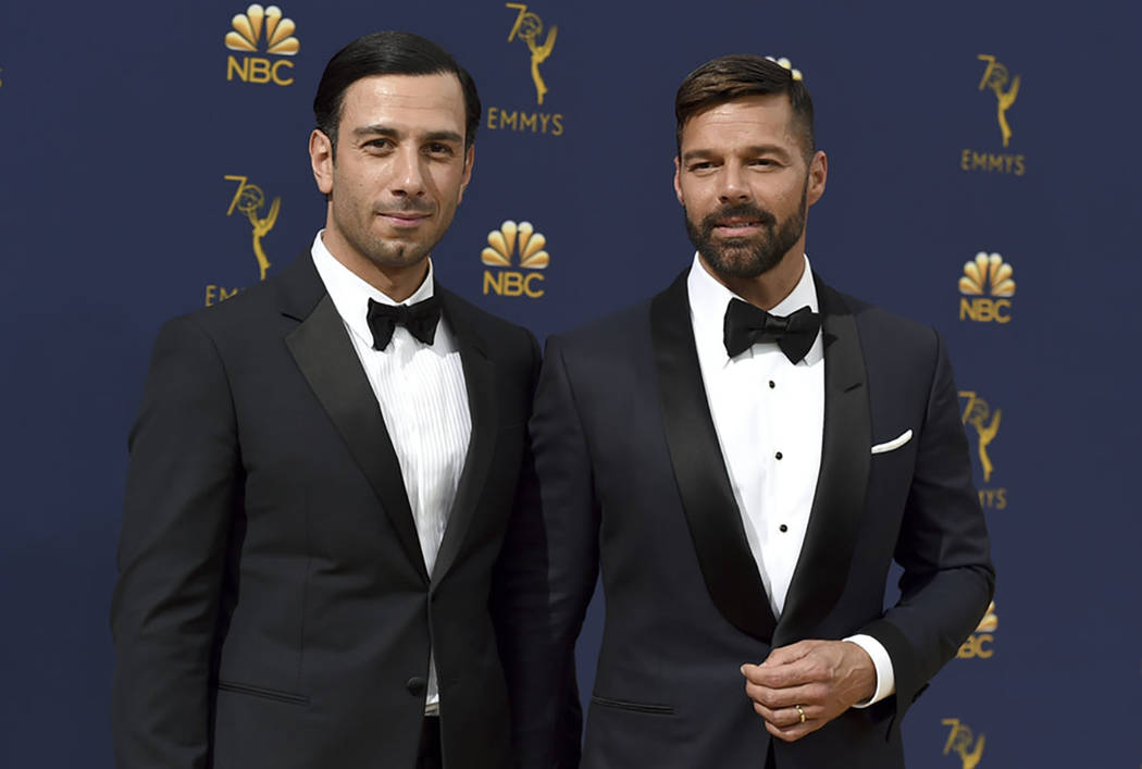 In this Monday, Sept. 17, 2018, photo, Jwan Yosef, left, and Ricky Martin arrive at the 70th Primetime Emmy Awards at the Microsoft Theater in Los Angeles. (Photo by Jordan Strauss/Invision/AP)
