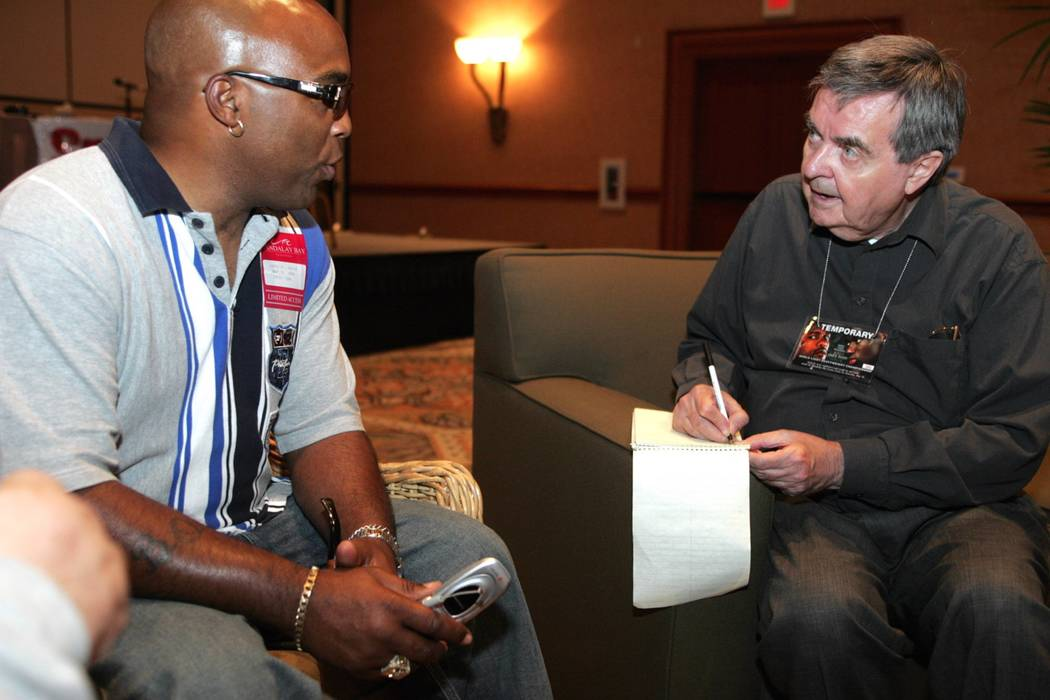 Sports--Legendary boxing writer Royce Feour, right, interviews former welterweight champion and current trainer Buddy McGirt Wednesday, May 12, 2004, during a press conference for the Roy Jones Jr ...