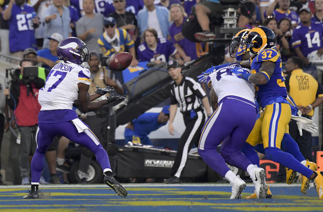 Minnesota Vikings wide receiver Aldrick Robinson, left, scores against the Los Angeles Rams during the first half in an NFL football game Thursday, Sept. 27, 2018, in Los Angeles. (AP Photo/Mark J ...