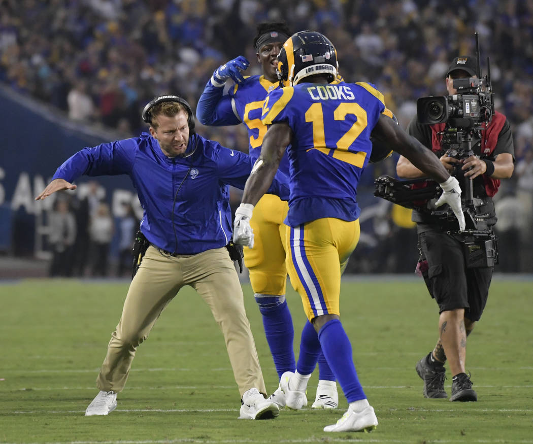 Los Angeles Rams head coach Sean McVay celebrates after a touchdown by wide receiver Brandin Cooks during the first half in an NFL football game against the Minnesota Vikings Thursday, Sept. 27, 2 ...