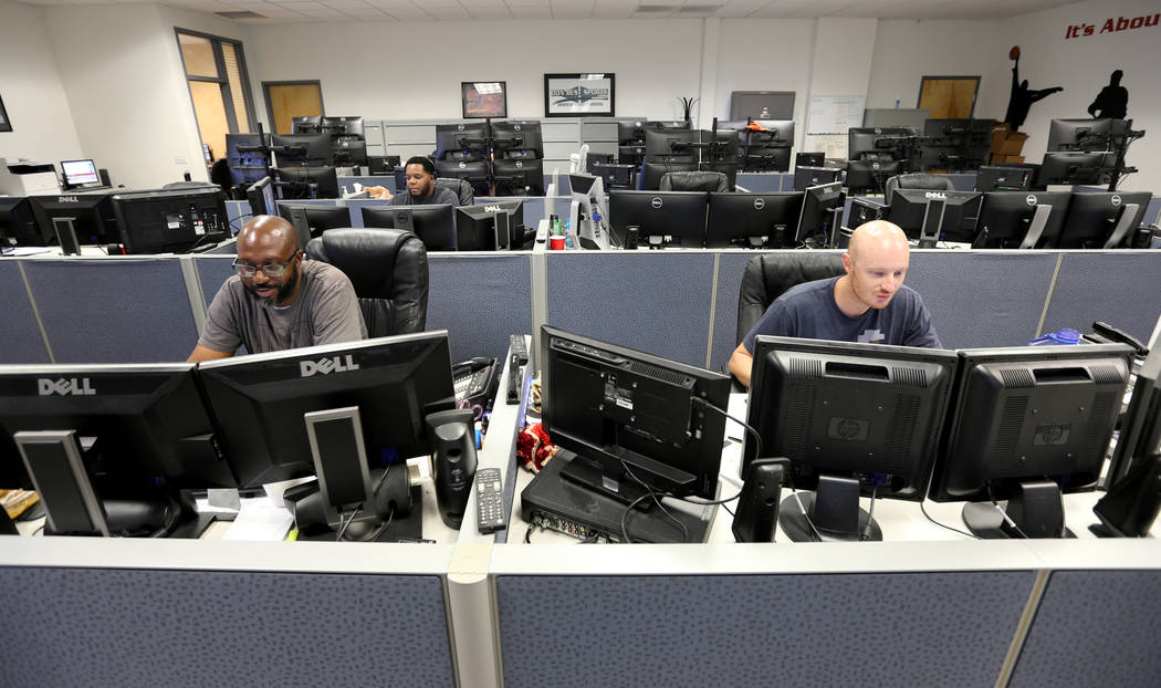Don Best Sports analysts, from left, Andre Burks, Marvin Holiday and Aaron Burns trade games in their Las Vegas office Thursday, Sept. 27, 2018. K.M. Cannon Las Vegas Review-Journal @KMCannonPhoto