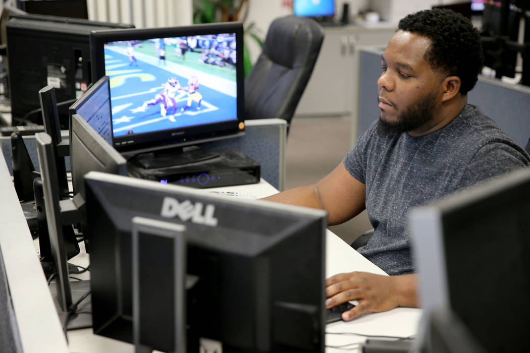 Don Best Sports analyst Marvin Holiday does in-game trading in his Las Vegas office Thursday, Sept. 27, 2018. K.M. Cannon Las Vegas Review-Journal @KMCannonPhoto