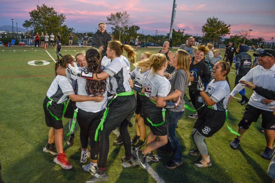 The under-14 girls flag football team that represents 200% Sports  celebrates winning the 221a83115
