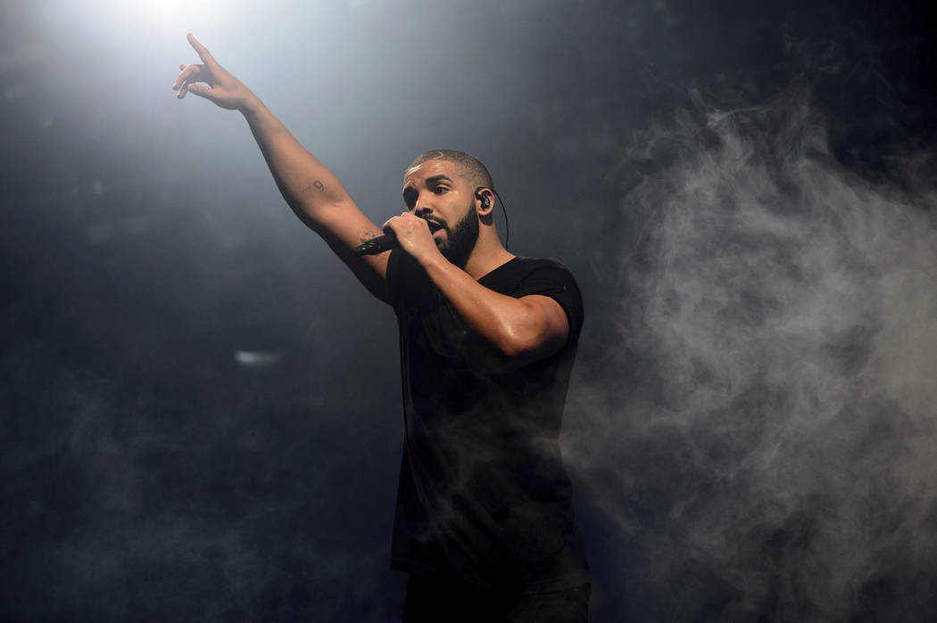 """FILE - In this June 27, 2015 file photo, Canadian singer Drake performs on the main stage at Wireless festival in Finsbury Park, London. Drake's """"Scorpion,"""" the highly anticipated, 2 ..."""