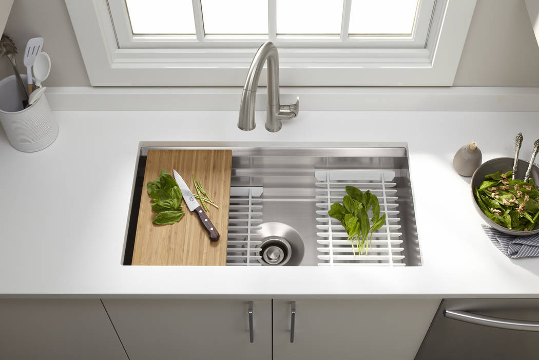 Kohler's stainless-steel Prolific sink addresses the varied needs of every person in the household related to both kitchen tasks and work height. Three different work zones and five accessories al ...