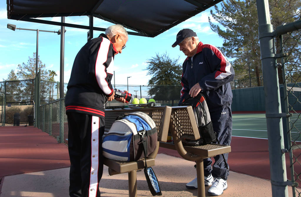 Janos Strauss, 90, left, and Alexander Kuechel, 94, both Holocaust survivors, prepare to play tennis at Mountain Shadows Community Center's tennis court on Thursday, Dec. 20, 2018, in Las Vegas. B ...
