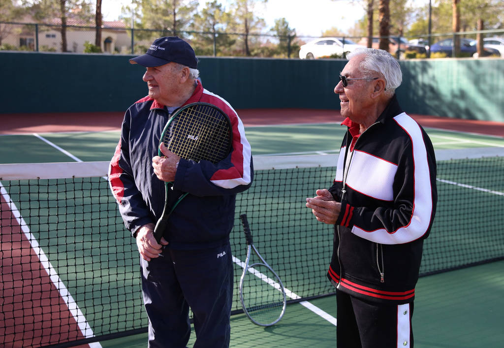 Janos Strauss, 90, left, and Alexander Kuechel, 94, both Holocaust survivors, chat prior to their tennis match at Mountain Shadows Community Center on Thursday, Dec. 20, 2018, in Las Vegas. Bizuay ...